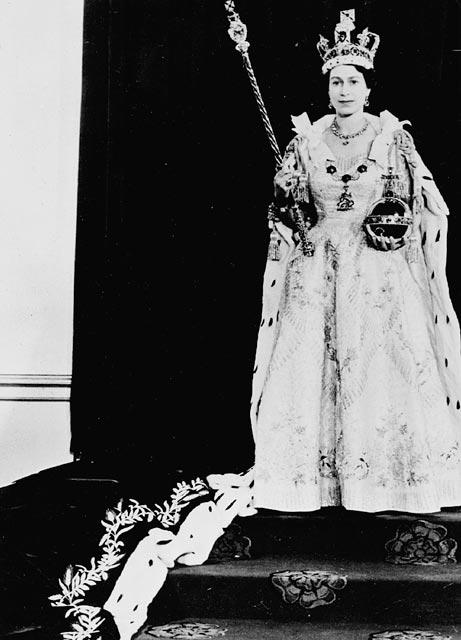 H.M. Queen Elizabeth II wearing her Coronation robes and regalia.